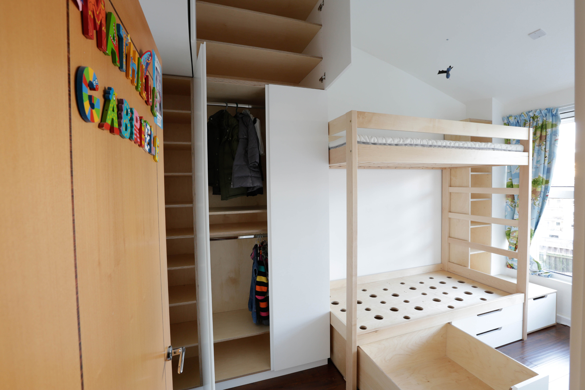 Buck beds made from sustainable sourced softwood, wardrobe cupboards and draws