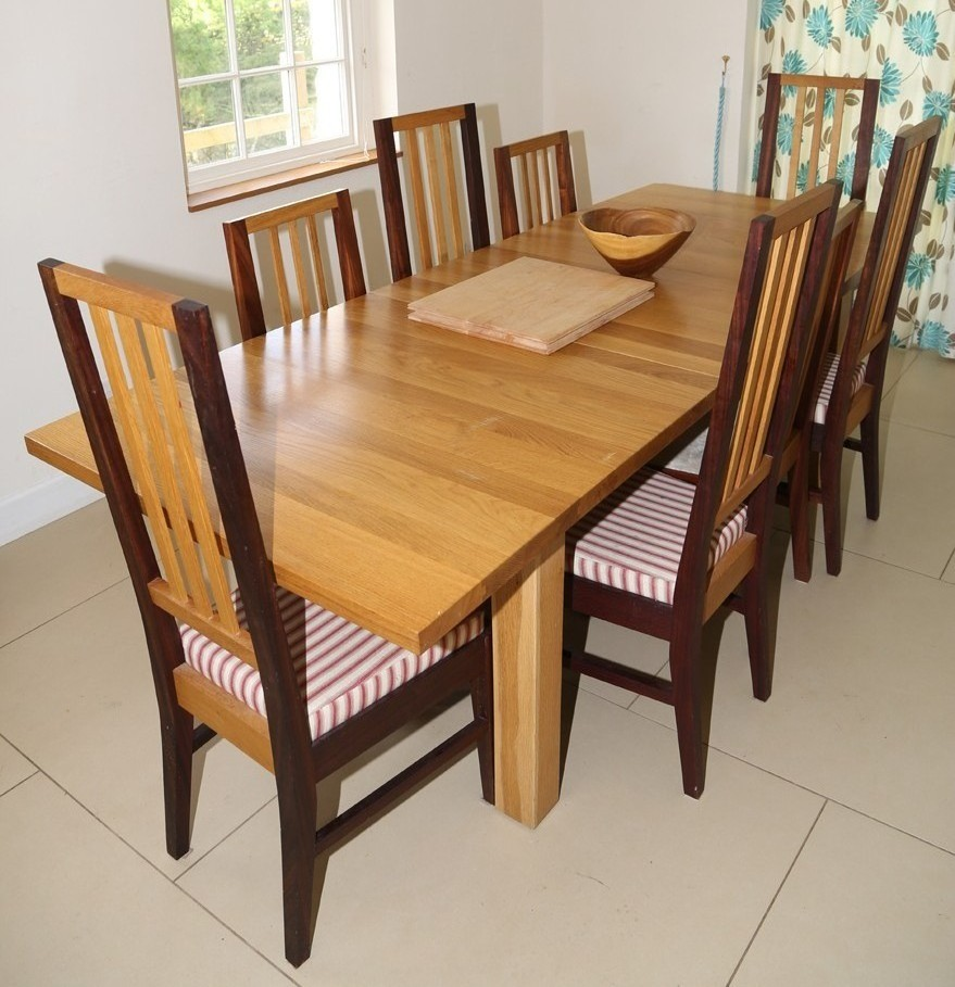 Dining table and chairs, using the contrasting colours of a selection of sustainable hardwoods